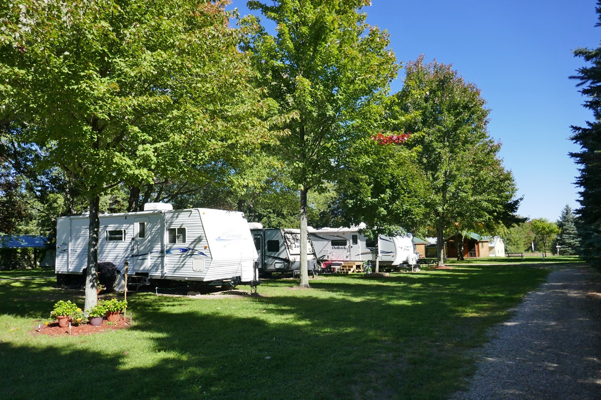 campsites with trailers and cabins