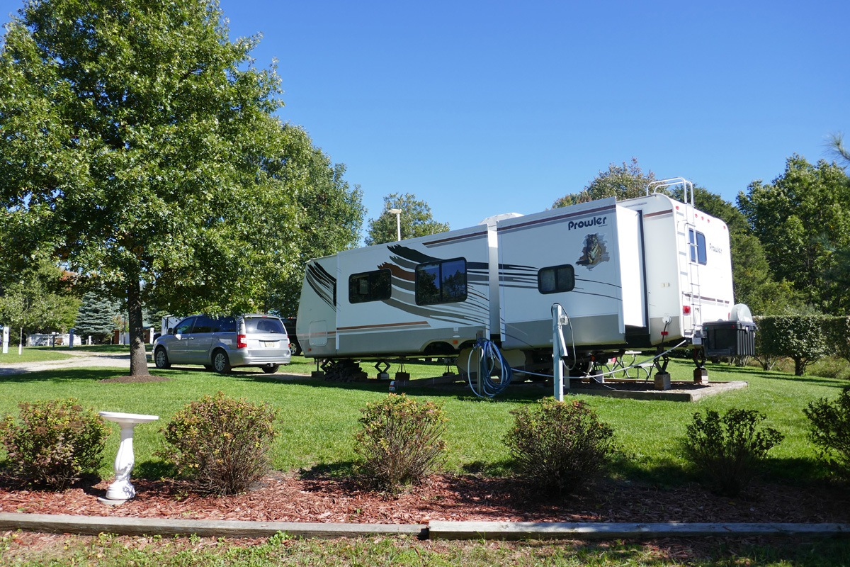 trailer on campsite with suv