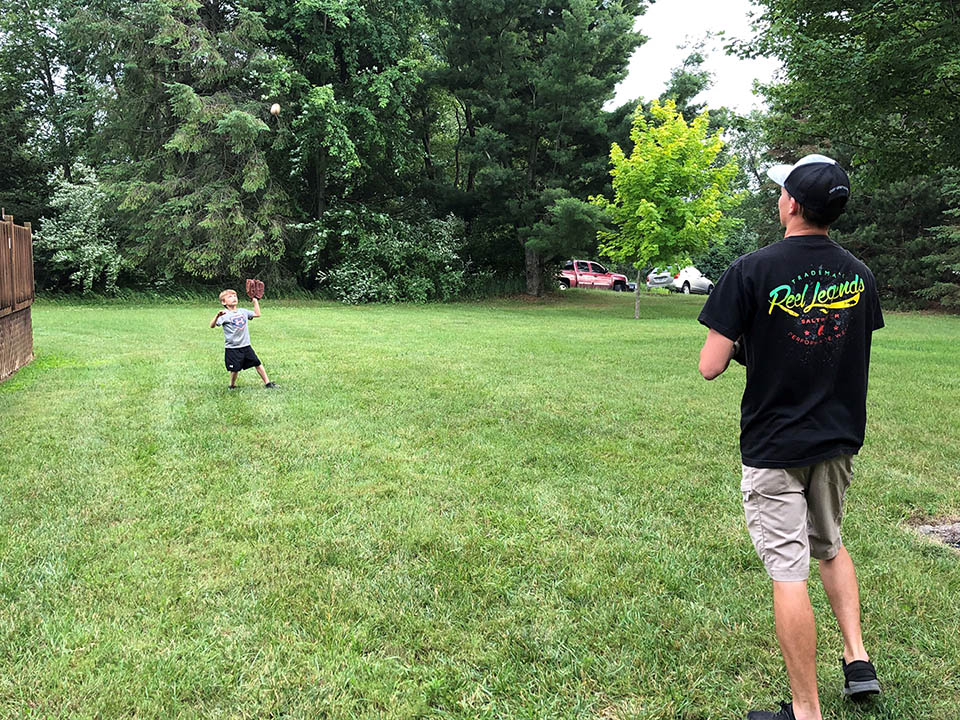 dad and young son playing catch